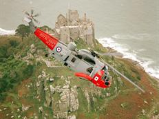 SAR Sea King from 771 NAS RNAS Culdrose over St Michael's Mount