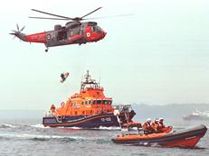 Sea King from 771 NAS working with a local lifeboat