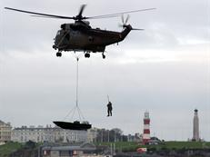 Sea King Mk4 conducting underslung boat transfer drills with Royal Marines from 539 Assault Squadron