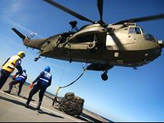 Sea King from 846NAS load lifting HMS Albion