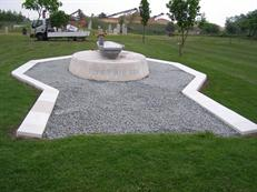 Memorial with added surround for plaques
