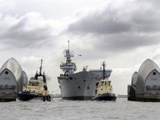 HMS Illustrious passing through the Thames Barrier