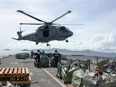 829 Merlin lifting aid to the Philippines