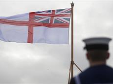 The White Ensign flies from the flight deck of HMS Queen Elizabeth