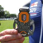 The Outlaw Triathlon Medal