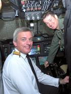 Vice Admiral Philip Jones CB, Fleet Commander with Lt Tom Hougham in the Merlin Mark cockpit