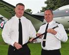 WO 1 AET Steve Cass (left) handing over BWO's cane to WO1 ACMN Paul Lofthouse