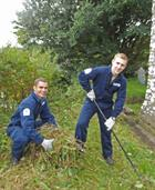 RNAS Culdrose Trainees clearing vegetation from St Mawgan in Meneage church