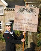 Ordinary Cadet Tristan Lane carrying the Nelson Banner, Madron parade