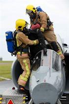 Royal Naval Aircraft Fire-fighter's rescuing the pilot of the exercised crashed Hawk jet