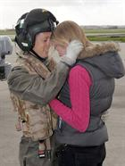 Miss C Stubbs welcomes Lt G H Walker back from HMS Daring