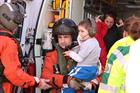 Jake being carried by Petty Officer Craig Gabraitis, Aircrewman and trainee paramedic