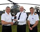 Cdre Jock Alexander presents WO1 Simon Arter Oder of St John; Surg Cdr Marcus Philpott also pictured
