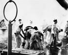 French sailors clear up damage, possibly on the Dunkerque. Picture Imperial War Museum
