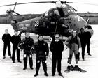 The duty Search and Rescue crew of a 771 NAS Wessex Mk5 pose in front of their helicopter in 1980