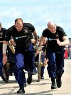 RNAS Culdrose field gun crew during a public run