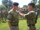 AET Alex Fisher being awarded the Queens Medal by Rear Admiral Paul Bennett OBE, COS JFC