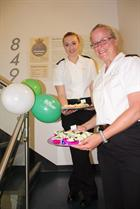 PO Lorry Osman, organiser of the Sea King Force Bake-Off ably assisted by AET Hollie Hill