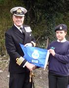 Captain Mark Garratt with Kettering Sea Cadets' efficiency burgee
