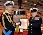 Admiral to the fleet, Lord Boyce presents Chief Petty Officer Derek Ashurst with the QCVS