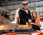 Air Engineering Technician (AET) Adam Geddes (19) Isabelle Mitchell (aged 10) cut the cake.