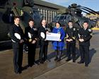 Cheque Presentation to Clare Scherer, Royal Navy and Royal Marines Children's Fund.