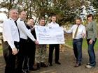 Servicemen from RNAS Culdrose present a cheque for the Community Covenant to Porthleven School