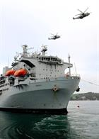 820 NAS Merlins fly over RFA Argus in Falmouth