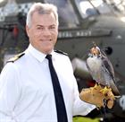 Commodore Jock Alexander OBE with Peregrine Falcon