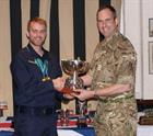 AET Dan Hinder receives one of his 10 trophies
