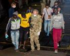 Migrants being assisted by the crew of HMS Bulwark
