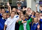 Capt Ade Orchard OBE with children of St Michael School Helston