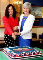 Kay Kendall and Louise Wainwright cutting the cake