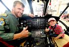 Lt Matt Taylor and Noah in Sea King cockpit