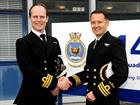 Commander Stu Finn handing over 814 NAS to Commander Brendan Spoors (right)