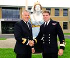 Commodore Alexander (left) handing-over RNAS Yeovilton (HMS HERON) to Commodore Pentreath – Crown co