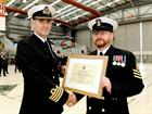 POAET Jack Malcolm receives his Commendation from Capt Adrian Orchard OBE