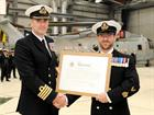WO 1 (ACMN) Jay O'Donnell receives his Warrant Officer Parchment from Capt Adrian Orchard OBE