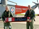RAdml Keith Blount [Left] hands over the signed Sea King tail rotor leaving gift to WOACMN Ian 'Zipp