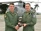 Lt Cdr Gary Jaggers receives a Merlin gift from Commander Steve Thomas CO 824 Sqn