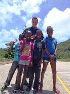 MASF's Naval Airman Hill raises the spirits of local children whilst delivering Bahamas Disaster