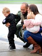 Petty Officer Ash Hinds, Stacey Partington, Jacob Partington, (3) and Isla Partington, (15 months)