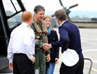 Flt Cdr Lt Dave Neyland and Wife Lizzy are welcomed back by Commodore (Cdre)  Jon Pentreath and Comm