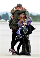 CPO Steve Wilson greets children Lauren (14) and Nat (7) after arriving back to 815 Naval Air Squadr