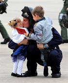 LAET Gav Babb kisses daughter Amie (2) after returning home to 815 Naval Air Squadron at RNAS Yeovil