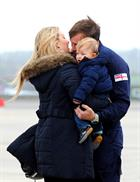 LAC John Brindley hug wife Lucretia and George (1) after returning home to 815 Naval Air Squadron at