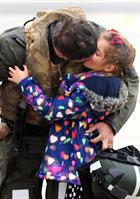 CPO Steve Wilson kisses daughter Nat (7) after returning home to 815 Naval Air Squadron at RNAS Yeov