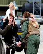 Lieutenant Max Cosby meets family members after returning to 815 Naval Air Squadron at RNAS Yeovilto