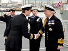 Vice Admiral Sir Philip Jones KCB being welcomed by HMS Dauntless' Commanding Officer Commander Guy.