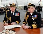 Vice Admiral Sir Philip Jones KCB (right) and the new Fleet Commander Vice Admiral Ben Key CBE signi